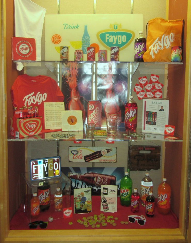 Showcase filled with Faygo pop bottles and items.
